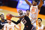 South Carolina's Seventh Woods (23) shoots while defended by Tennessee's Yves Pons (35) during an NCAA college basketball game Wednesday, Feb. 17, 2021, in Knoxville, Tenn. (Brianna Paciorka/Knoxville News Sentinel via AP, Pool)