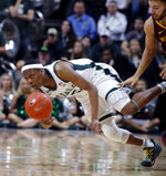 Michigan State's Cassius Winston, left, dives for the ball on a steal against Minnesota's Gabe Kalscheur, right, during the second half of an NCAA college basketball game, Saturday, Feb. 9, 2019, in East Lansing, Mich. Michigan State won 79-55. (AP Photo/Al Goldis)