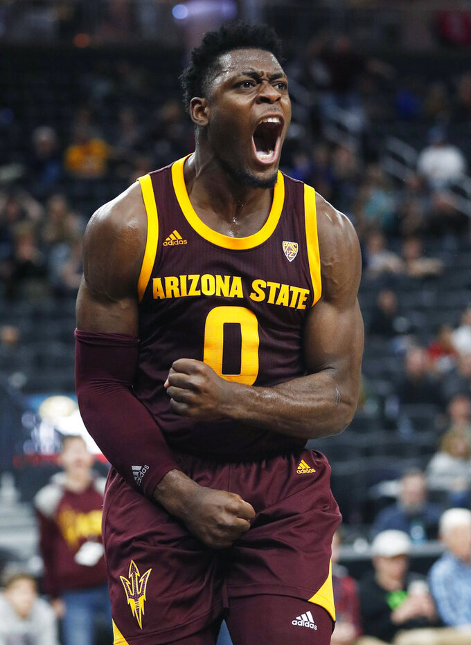 FILE - In this Nov. 21, 2018, file photo, Arizona State 's Luguentz Dort celebrates after scoring during the second half of an NCAA college basketball game against Utah State in Las Vegas. At 6-foot-4, 215 pounds, he's built like linebacker on the Arizona State football team, not some scrawny teenager disdainfully bumped out of the lane on a basketball court. (AP Photo/John Locher, File)