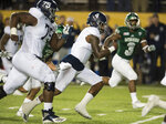 Georgia Southern quarterback Shai Werts (4) runs into the end zone for a touchdown during the Camellia Bowl  NCAA college football game  in Montgomery, Ala., on Saturday, Dec. 15, 2018. (Jake Crandall/The Montgomery Advertiser via AP)