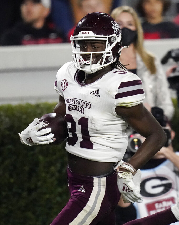 Mississippi State wide receiver Jaden Walley scores a touchdown against Georgiaduring the first half of an NCAA college football game, Saturday, Nov. 21, 2020, in Athens, Ga. (AP Photo/Brynn Anderson)