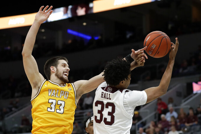 Valparaiso's John Kiser, left, and Missouri State's Josh Hall reach for a loose ball during the first half of an NCAA college basketball game in the semifinal round of the Missouri Valley Conference men's tournament Saturday, March 7, 2020, in St. Louis. (AP Photo/Jeff Roberson)
