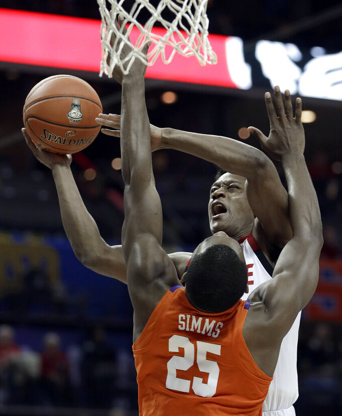 North Carolina State's C.J. Bryce, top. shoots over Clemson's Aamir Simms (25) during the first half of an NCAA college basketball game in the Atlantic Coast Conference tournament in Charlotte, N.C., Wednesday, March 13, 2019. (AP Photo/Nell Redmond)