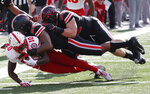 Nebraska receiver JD Spielman, left, is tackled by Ohio State defenders Brendon White, center, and Luke Donovan during the first half of an NCAA college football game Saturday, Nov. 3, 2018, in Columbus, Ohio. (AP Photo/Jay LaPrete)