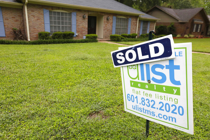 FILE- This April 23, 2018, file photo shows a sold sign in front of a home in Jackson, Miss. On Thursday, May 17, Freddie Mac reports on the week's average U.S. mortgage rates. (AP Photo/Rogelio V. Solis, File)
