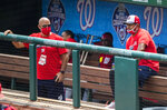 FILE  - In this Sunday, Aug. 2, 2020, file photo, Washington Nationals manager Dave Martinez, right, with General Manager Mike Rizzo, left, watch from the dugout a baseball intrasquad game at Nationals Park in Washington. For the second season in a row, manager Dave Martinez's Washington Nationals got off to a 19-31 start. This time, there were not enough games to dig themselves out of that hole. (AP Photo/Manuel Balce Ceneta, File)