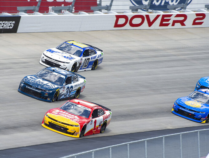 FILE - In this Aug. 23, 2020 file photo, Michael Annett (1), Ryan Sieg (39), and Ross Chastain (10) compete in a NASCAR Xfinity Series auto race at Dover International Speedway, in Dover, Del.  On Friday, May 14,  The Associated Press reported on stories circulating online incorrectly claiming gas shortages resulting from the Colonial Pipeline cyberattack have led NASCAR to postpone this weekend's race in Dover. (AP Photo/Jason Minto, File)