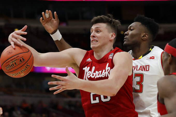 Nebraska's Tanner Borchardt (20) battles for a loose ball against Maryland's Bruno Fernando (23) during the second half of an NCAA college basketball game in the second round of the Big Ten Conference tournament, Thursday, March 14, 2019, in Chicago. (AP Photo/Nam Y. Huh)
