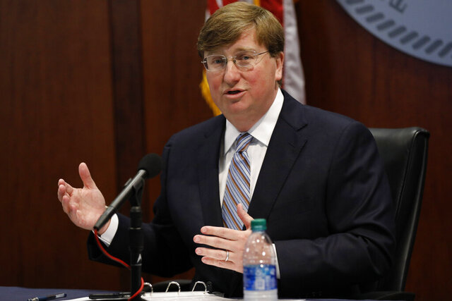 Mississippi Gov. Tate Reeves speaks about his executive order relaxing restrictions on nightclubs and bars during the daily COVID-19 news update in Jackson, Miss., Wednesday, June 10, 2020. (AP Photo/Rogelio V. Solis)
