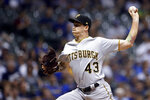 Pittsburgh Pirates' Steven Brault pitches during the first inning of the team's baseball game against the Milwaukee Brewers on Friday, Sept. 20, 2019, in Milwaukee. (AP Photo/Aaron Gash)