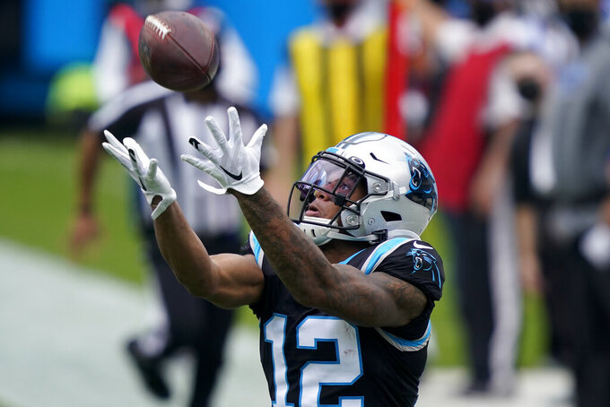 Carolina Panthers wide receiver D.J. Moore catches a pass during the first half of an NFL football game against the Detroit Lions Sunday, Nov. 22, 2020, in Charlotte, N.C. (AP Photo/Gerry Broome)