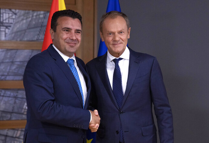 European Council President Donald Tusk, right, greets North Macedonia's Prime Minister Zoran Zaev prior to a meeting at the European Council building in Brussels, Wednesday, Oct. 16, 2019. (AP Photo/Virginia Mayo, Pool)