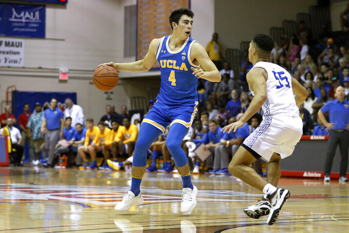 UCLA guard Jaime Jaquez Jr. (4) tries to get around Chaminade guard Isaac Amaral-Artharee during the first half of an NCAA college basketball game Tuesday, Nov. 26, 2019, in Lahaina, Hawaii. (AP Photo/Marco Garcia)