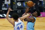 Oklahoma City Thunder forward Justin Jackson (44) defends Miami Heat forward Jimmy Butler (22) during the second half of an NBA basketball game, Monday, Jan. 4, 2021, in Miami. (AP Photo/Marta Lavandier)