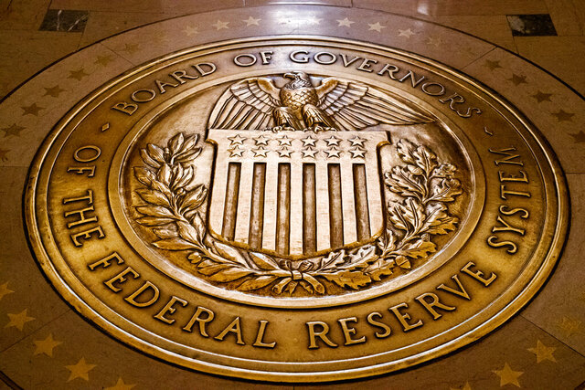 FILE - In this Feb. 5, 2018, file photo, the seal of the Board of Governors of the U.S, Federal Reserve System lies embedded in the floor at the Marriner S. Eccles Federal Reserve Board Building in Washington. The Federal Reserve announced late Wednesday, March 18, 2020, that it will establish an emergency lending facility to help unclog a short-term credit market that has been disrupted by the coronavirus outbreak. The Fed said it will lend money to banks that purchase financial assets from money market mutual funds, including short-term IOUs known as commercial paper. (AP Photo/Andrew Harnik, File)