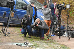News media film broken glass and car parts on the road side near to the Sandringham Estate, England, where Prince Philip was involved in a road accident Thursday while he was driving, Friday Jan. 18, 2019. Witnesses say Queen Elizabeth II's 97-year old husband Prince Philip was helped out of his car after it rolled over in the accident on the busy road. (John Stillwell/PA via AP)