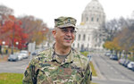 Michael Creagan, the only Catholic chaplain in the Minnesota National Guard, talks with a reporter Oct. 19, 2020, the State Capitol in the background in St. Paul, Minn. where he celebrated Mass for a handful of soldiers bunking there after the call up of the Guard during civil unrest after the death of George Floyd at the hands of Minneapolis police. (AP Photo/Jim Mone)