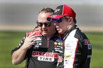 Brad Keselowski, right, talks with a crew member on pit road during NASCAR auto race qualifying at Daytona International Speedway, Sunday, Feb. 9, 2020, in Daytona Beach, Fla. (AP Photo/John Raoux)