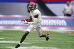 Alabama wide receiver Jameson Williams (1) runs for a touchdown after a catch during the second half of an NCAA college football game against Miami, Saturday, Sept. 4, 2021, in Atlanta. (AP Photo/John Bazemore)