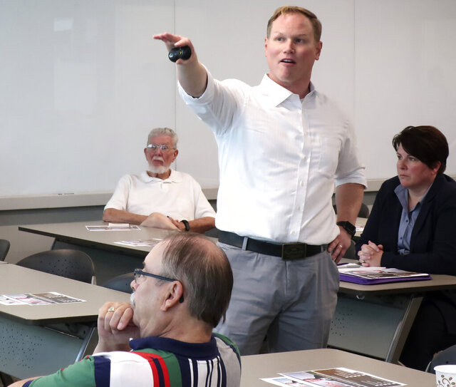 FILE - In this Aug. 26, 2019, file photo, U.S. Rep. Steve Watkins, R-Kan., makes a point during a town hall meeting, in Topeka, Kan. Watkins, a freshman Kansas congressman who had listed a UPS Inc. store as his residence on a voter registration, was criminally charged Tuesday, July 14, 2020, with four crimes, including unlawful voting. (AP Photo/John Hanna, File)