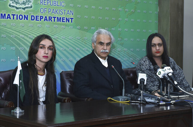 Dr. Zafar Mirza, center, Special Assistant to the Prime Minister on National Health, addresses a news conference with members of the Pakistani transgender community in Islamabad, Pakistan, Tuesday, Dec. 31, 2019. Pakistan has begun issuing special health care cards for transgender people. They have often been denied treatment because doctors could not decide whether to treat them in a male or female ward. (AP Photo/B.K. Bangash)