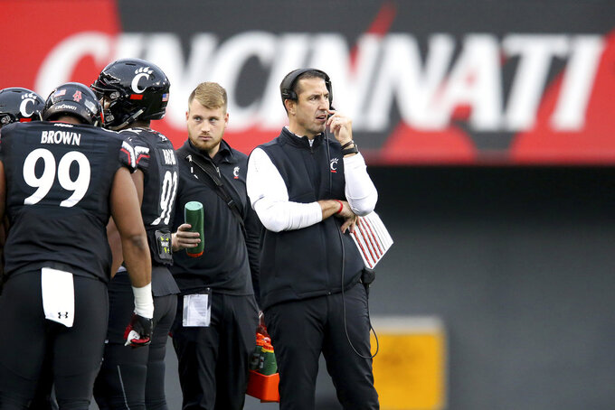 Cincinnati Bearcats head coach Luke Fickell talks into the headset during a timeout in the second quarter of an NCAA college football game, against East Carolina Friday, Nov. 23, 2018, in Cincinnati.   (Kareem Elgazzar/The Cincinnati Enquirer via AP)