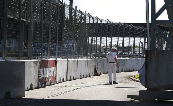 The track is void of cars after at the IndyCar Grand Prix of St. Petersburg, Friday, March 13, 2020 in St. Petersburg. NASCAR and IndyCar have postponed their weekend schedules at Atlanta Motor Speedway and St. Petersburg, due to concerns over the COVID-19 pandemic. (Dirk Shadd/Tampa Bay Times via AP)