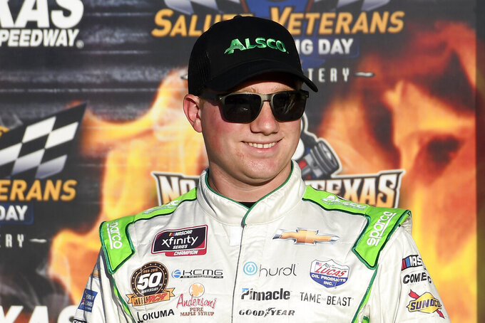 Tyler Reddick stands in Victory Lane after earning the pole for the NASCAR Xfinity Series auto race at Texas Motor Speedway in Fort Worth, Texas, Saturday, Nov. 2, 2019. (AP Photo/Randy Holt)