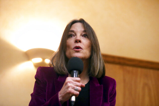 FILE - In this Nov. 30, 2019, file photo, Democratic presidential candidate Marianne Williamson speaks at a campaign stop at Body and Soul Wellness Center in Dubuque, Iowa. The bestselling author and spiritual guru has laid off her entire 2020 campaign staff but is pushing ahead with her Democratic presidential bid, two former staffers said Thursday, Jan. 2, 2020. (Eileen Meslar/Telegraph Herald via AP)