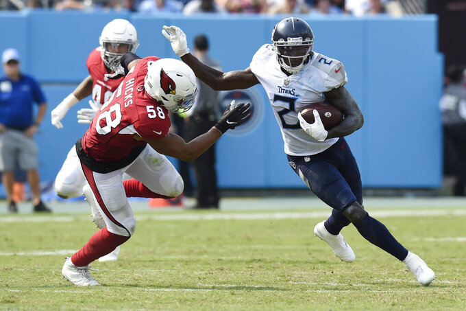 Tennessee Titans wide receiver Julio Jones (2) evades Arizona Cardinals middle linebacker Jordan Hicks (58) in the second half of an NFL football game Sunday, Sept. 12, 2021, in Nashville, Tenn. (AP Photo/Mark Zaleski)