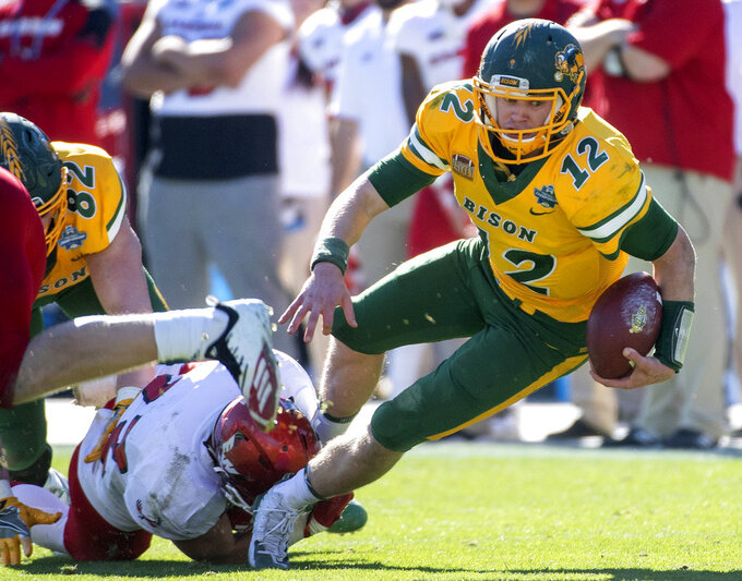 North Dakota State quarterback Easton Stick (12) reaches for extra yardage as he is brought down by Eastern Washington defensive back Tysen Prunty (22) during the second half of the FCS championship NCAA college football game, Saturday, Jan. 5, 2019, in Frisco, Texas. (AP Photo/Jeffrey McWhorter)