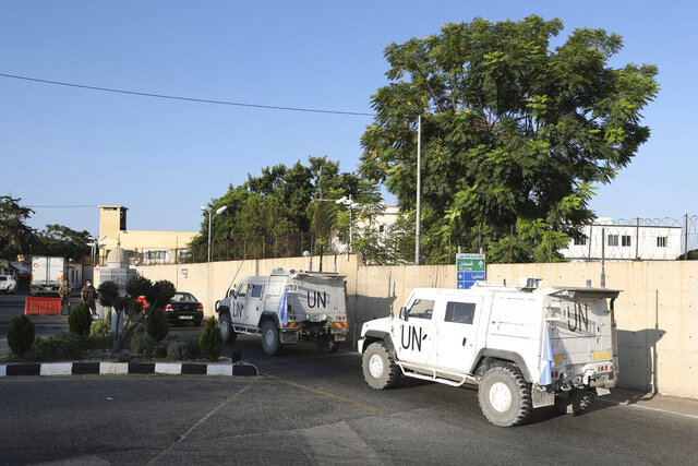 U.N. peacekeeping military vehicles enter the headquarters of the U.N. peacekeeping force in the southern Lebanese border town of Naqoura, Lebanon, Wednesday, Oct. 14, 2020. Lebanon and Israel are to begin Wednesday indirect talks over the disputed maritime border between the two countries in the presence of American officials who are mediating between the Middle Eastern nations. (AP Photo/Bilal Hussein)