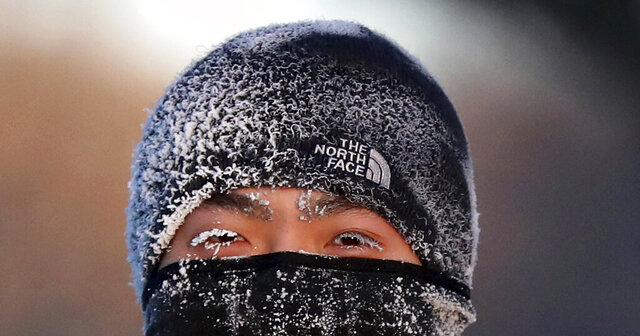 A runner wears the cold on his face while running along West River Parkway hills Thursday, Feb. 13, 2020, near downtown Minneapolis, with temperatures hovering near minus 30 degrees Fahrenheit with wind chills. (David Joles/Star Tribune via AP)