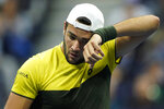 Matteo Berrettini, of Italy, wipes sweat from his face during the men's singles semifinals of the U.S. Open tennis championships against Rafael Nadal, of Spain, Friday, Sept. 6, 2019, in New York. (AP Photo/Eduardo Munoz Alvarez)