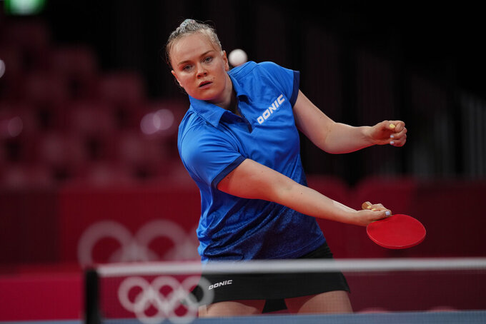 Bulgaria's Polina Trifonova competes during the table tennis women's singles first round match against Luxembourg's Sarah De Nutte at the 2020 Summer Olympics, Saturday, July 24, 2021, in Tokyo. (AP Photo/Kin Cheung)