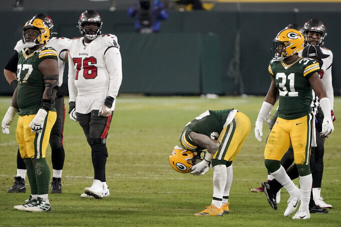 Green Bay Packers' Jaire Alexander (23) reacts after being called for pass interference against the Tampa Bay Buccaneers during the second half of the NFC championship NFL football game in Green Bay, Wis., Sunday, Jan. 24, 2021. (AP Photo/Morry Gash)