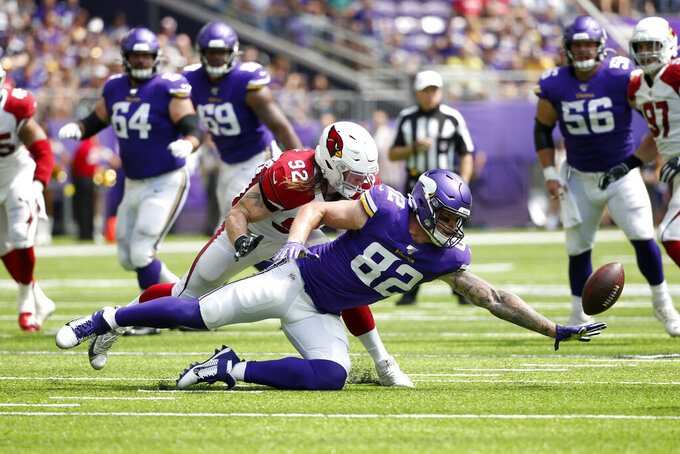 Arizona Cardinals linebacker Dennis Gardeck (92) breaks up a pass intended for Minnesota Vikings tight end Kyle Rudolph (82) during the first half of an NFL preseason football game, Saturday, Aug. 24, 2019, in Minneapolis. (AP Photo/Bruce Kluckhohn)