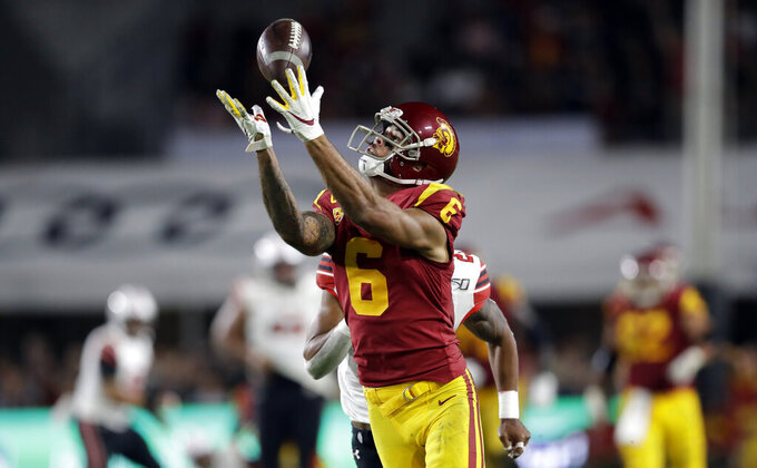 Southern California wide receiver Michael Pittman Jr. (6) makes a catch against Utah during the second half of an NCAA college football game Friday, Sept. 20, 2019, in Los Angeles. (AP Photo/Marcio Jose Sanchez)