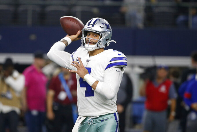 Dallas Cowboys quarterback Dak Prescott (4) throws a pass in the second half of an NFL football game against the Buffalo Bills in Arlington, Texas, Thursday, Nov. 28, 2019. (AP Photo/Ron Jenkins)