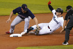 Miami Marlins' Corey Dickerson, right, is tagged out at second by Boston Red Sox third baseman Christian Arroyo, left, during the first inning of a baseball game, Tuesday, Sept. 15, 2020, in Miami. (AP Photo/Lynne Sladky)