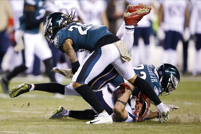 New England Patriots' Julian Edelman (11) is tackled by Philadelphia Eagles' Rodney McLeod (23) and Avonte Maddox (29) during the first half of an NFL football game, Sunday, Nov. 17, 2019, in Philadelphia. (AP Photo/Michael Perez)