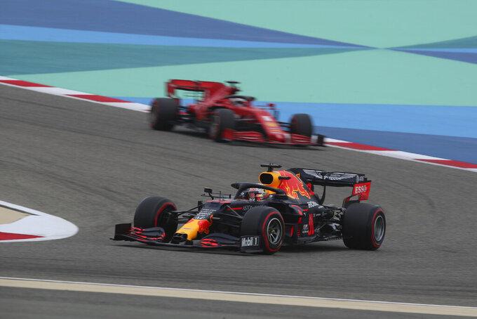 Red Bull driver Max Verstappen of the Netherlands, foreground, and Ferrari driver Sebastian Vettel of Germany steer their cars during the third free practice at the Formula One Bahrain International Circuit in Sakhir, Bahrain, Saturday, Nov. 28, 2020. (Tolga Bozoglu, Pool via AP)