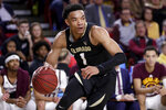 Colorado guard Tyler Bey (1) looks to pass against Arizona State during the first half of an NCAA college basketball game, Thursday, Jan. 16, 2020, in Tempe, Ariz. (AP Photo/Matt York)