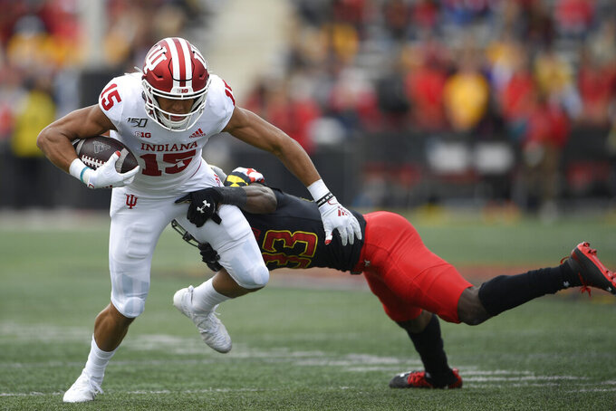 Indiana wide receiver Nick Westbrook (15) runs with the ball against Maryland defensive back Deonte Banks (33) during the first half of an NCAA college football game, Saturday, Oct. 19, 2019, in College Park, Md. (AP Photo/Nick Wass)