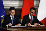 China's Commerce Minister Zhong Shan, left, and Italian Labor Minister Luigi Di Maio sign a memorandum of understanding at Rome's Villa Madama, Saturday, March 23, 2019. Italy signed a memorandum of understanding with China on Saturday in support of Beijing's