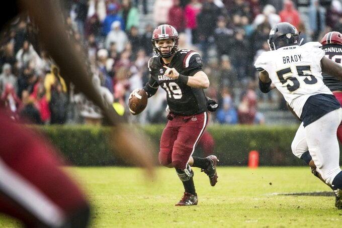 South Carolina quarterback Jake Bentley (19) looks for an open teammate during the first half of an NCAA college football game against Akron Saturday, Dec. 1, 2018, in Columbia, S.C. South Carolina defeated Akron 28-3. (AP Photo/Sean Rayford)