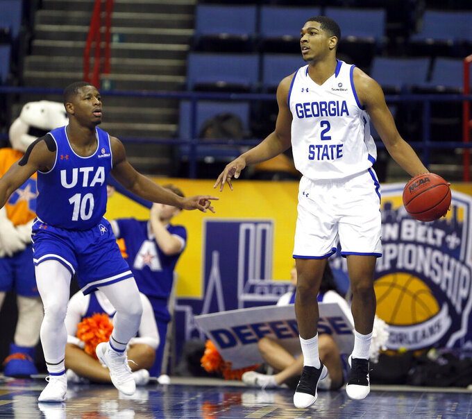 Georgia State forward Malik Benlevi (2) is defended by Texas-Arlington guard Radshad Davis (10) during the first half of an NCAA college basketball game during the championship game of the Sun Belt Conference men's tournament in New Orleans, Sunday, March 17, 2019. (AP Photo/Tyler Kaufman)