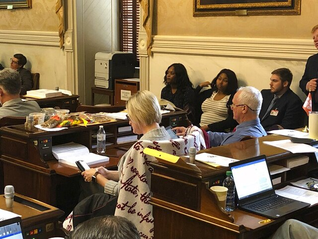 Rep. Ashley Trantham, a Republican from Greenville, keeps snacks on her desk during the state budget debate at the South Carolina Statehouse in Columbia, South Carolina, on Tuesday, March 10, 2020. House members debated whether to give state employees an across the board raise. (AP Photo / Jeffrey Collins)