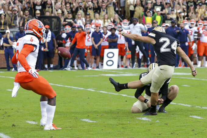 Purdue kicker Mitchell Fineran (24) boots a field goal against Illinois during the first quarter of an NCAA college football game, Saturday, Sept. 25, 2021, in West Lafayette, Ind. (Nikos Frazier/Journal & Courier via AP)