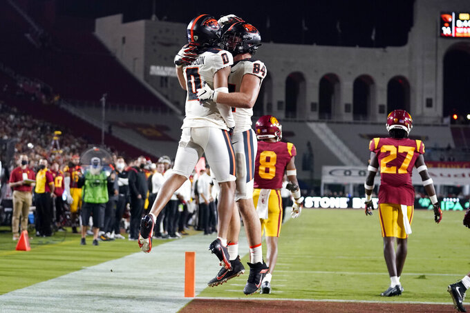 Oregon State wide receiver Tre'Shaun Harrison (0) celebrates his touchdown catch with tight end Teagan Quitoriano (84) during the first half of an NCAA college football game against Southern California Saturday, Sept. 25, 2021, in Los Angeles. (AP Photo/Marcio Jose Sanchez)